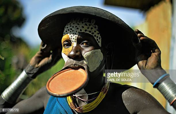 A woman from the Suri tribe with a lip plate poses in Ethiopia's southern Omo Valley region near Kibbish on September 25 2016 The Suri are a...