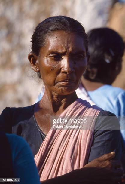 A woman from the Tevar caste whose house was burned looks at the destruction October 1 1997 in Karaiyiruppu India Tevar caste members and residents...