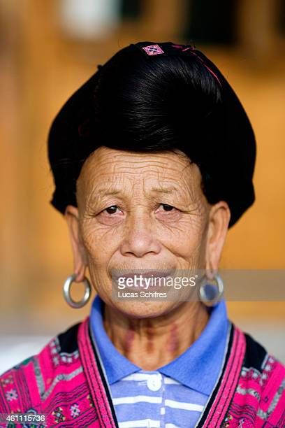A woman from the Yao ethnic minority poses for a photograph on October 29 2009 in Longji near Guilin Guangxi province China The Yao nationality is...