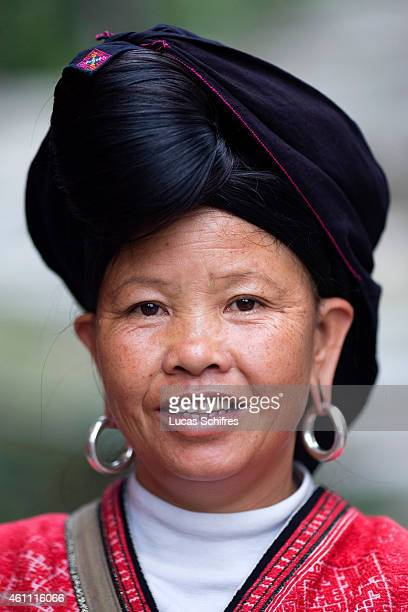 A woman from the Yao ethnic minority poses for a photograph on October 28 2009 in Longji near Guilin Guangxi province China The Yao nationality is...