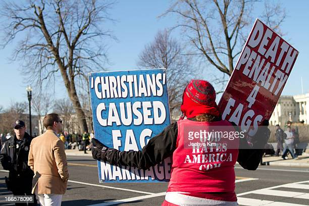Woman from Westboro Baptist Church rallies against gay marriage at the Supreme Court during the Prop 8 and DOMA hearing in 2013.