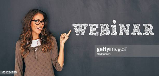 woman front of blackboard - webinar stock photos and pictures