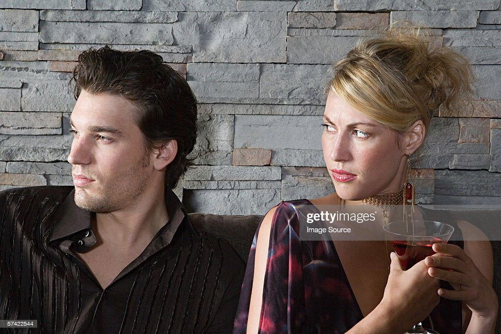 Woman frowning at boyfriend : Stock Photo