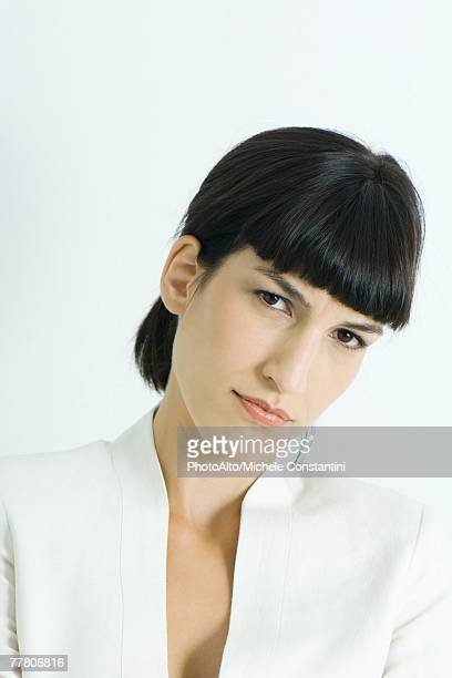 woman, frowning at camera, portrait - three quarter front view stock pictures, royalty-free photos & images