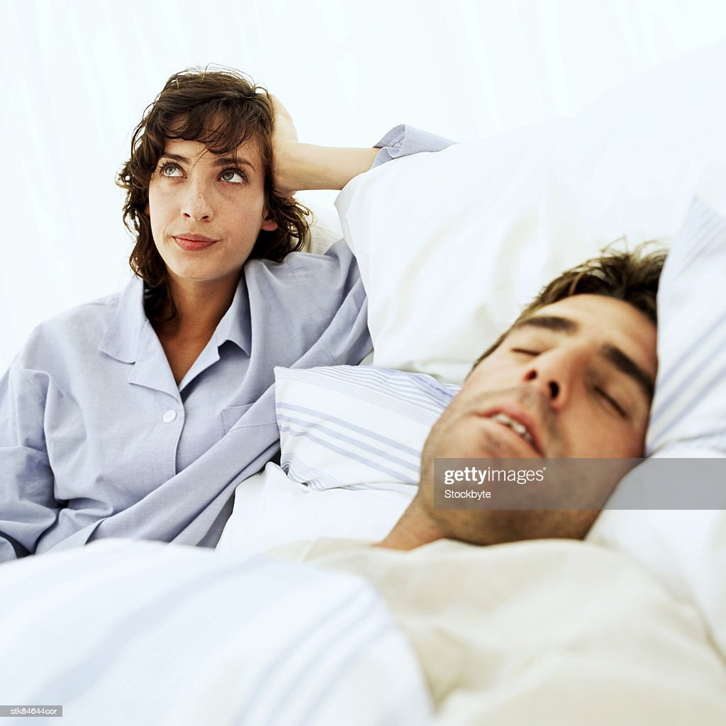 woman frustrated at man's snoring : Stock Photo