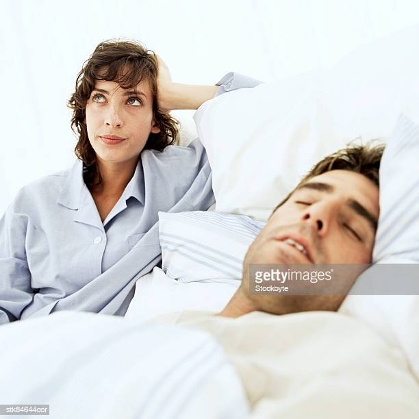 woman frustrated at man's snoring