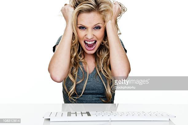Woman frustrated using a computer