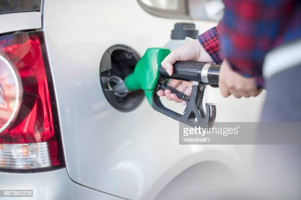 woman fueling car - petrol stock photos and pictures