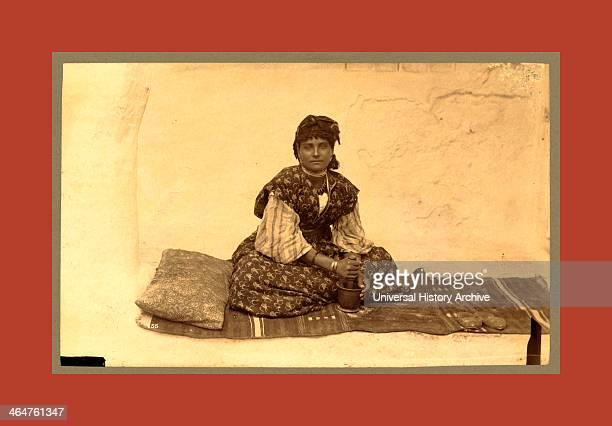 Woman Fulllength Portrait Seated On Rug On Ground Facing Front Using Mortar And Pestle Constantine Algeria Neurdein Brothers 1860 1890 The Neurdein...