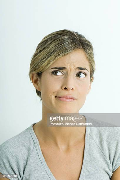 """Woman, furrowing brow, looking away, portrait"""