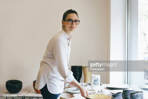 woman gallerist working, a portrait - art dealer stock pictures, royalty-free photos & images