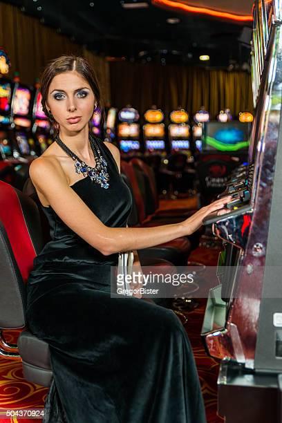 Woman gambling in the casino on slot machines
