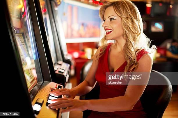 Woman gambling in the casino.