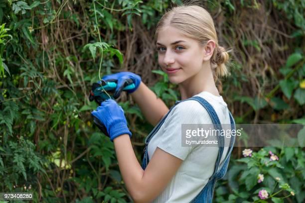 Woman gardener pruning