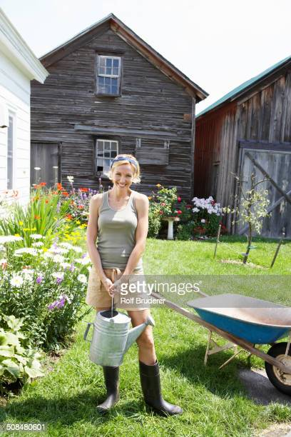 Woman gardening in backyard