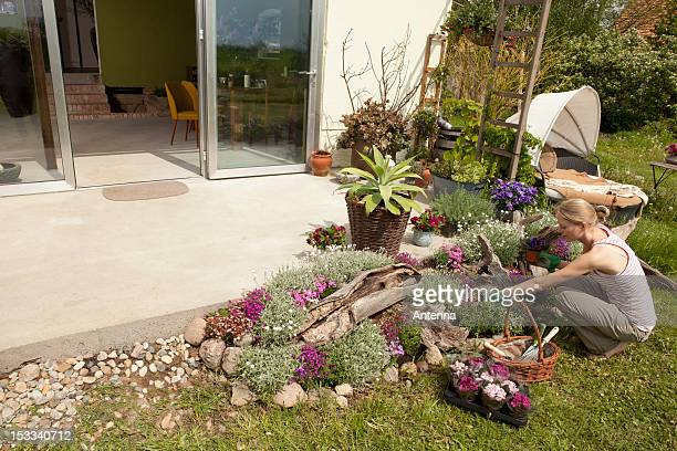 A woman gardening in her back yard, high angle view