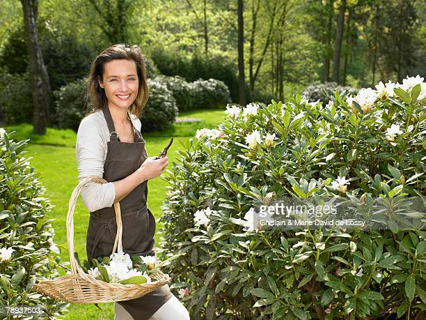 Woman gardening outdoors smiling.