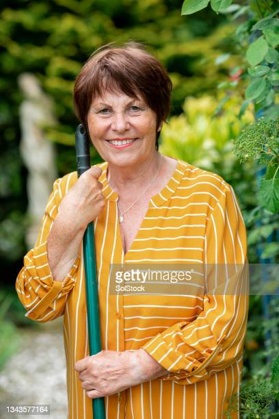 a woman gardening - morpeth stock pictures, royalty-free photos & images