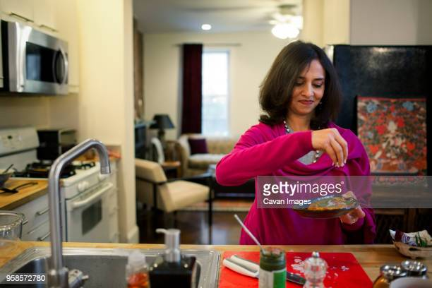 Woman garnishing food