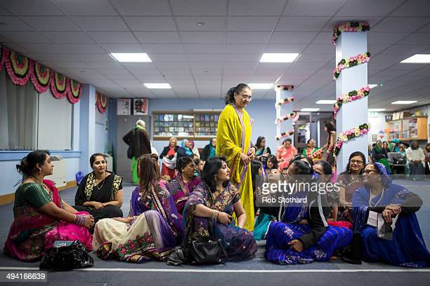 Woman gather in the temporary prayer hall at Shree Swaminarayan Mandir a major new Hindu temple being built in Kingsbury before a visit by Mayor of...