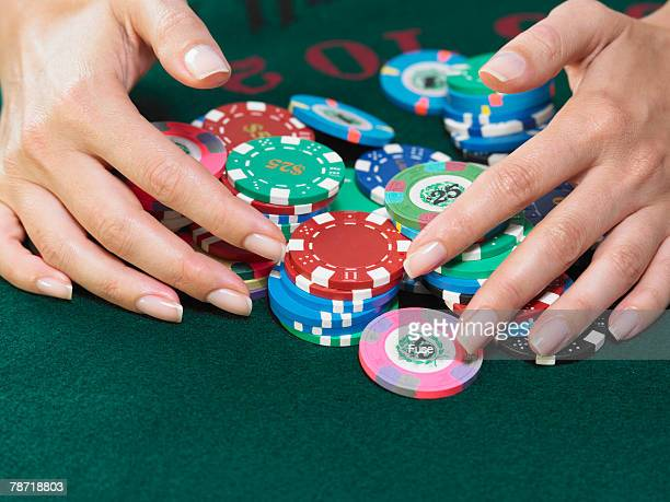 woman gathering winnings - winnings stock photos and pictures