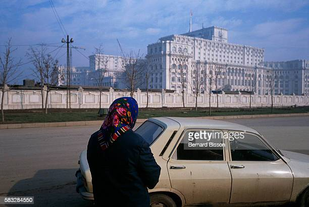 A woman gazes at President Ceausescu's palace in Bucharest on November 24 1989 In the coming weeks Communist dictator Nicolae Ceausescu faces...