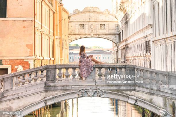 woman gazing at bridge of sighs - ponte dei sospiri, venice, italy. - venice italy stock pictures, royalty-free photos & images