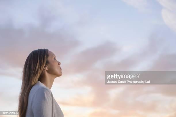 Woman gazing at sky