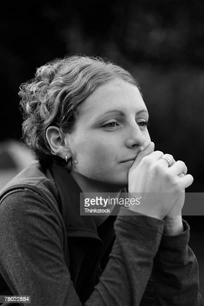woman gazing into the distance - thinkstock stock-fotos und bilder