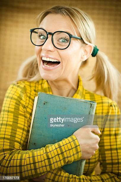 Woman geek holding her book.