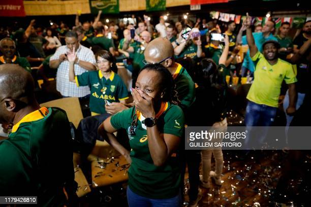 A woman gestures as she cries as South Africans celebrate after South Africa won the Rugby World Cup 2019 Final between South Africa and England at...