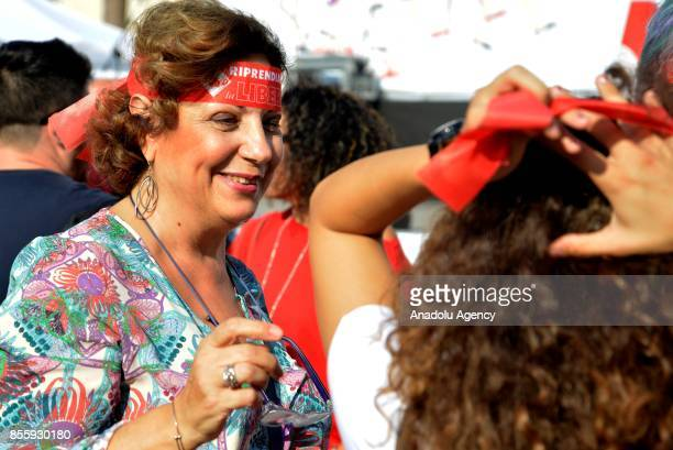 A woman gestures during a protest against genderbased violence in Rome Italy on September 30 2017