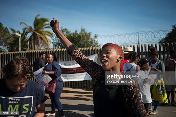A woman gestures during a protest against ongoing violence against women in Gugulethu on May 21 about 20 Km from the centre of Cape Town This protest...