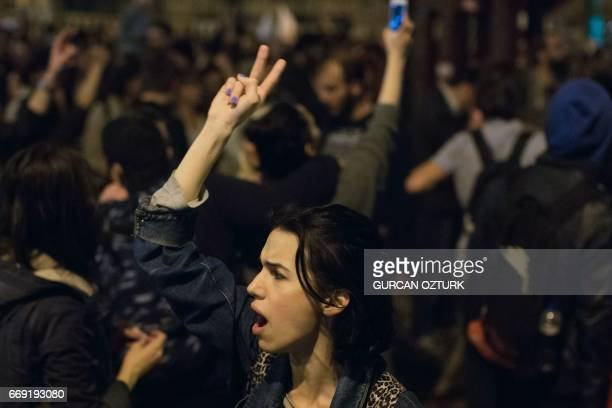 A woman gestures during a protest against the Turkish President on April 16 2017 in Istanbul after the results of a nationwide referendum that will...