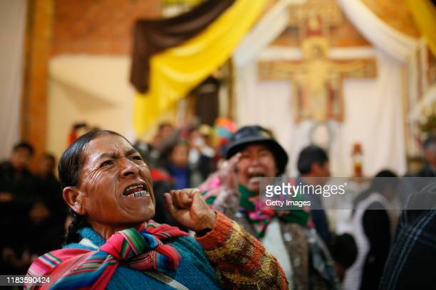 A woman gestures during the funeral of people killed yesterday during clashes between supporters of Evo Morales and security forces in the entrance...