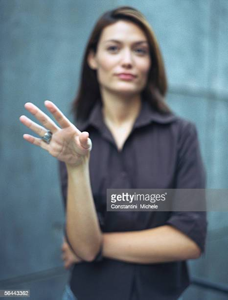 woman gesturing, defocused - weigeren stockfoto's en -beelden