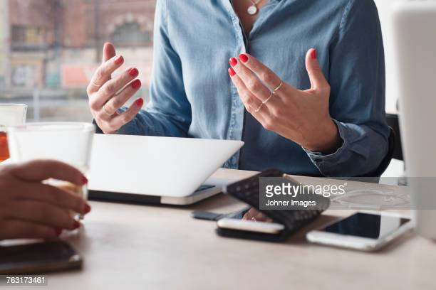 Woman gesturing during meeting