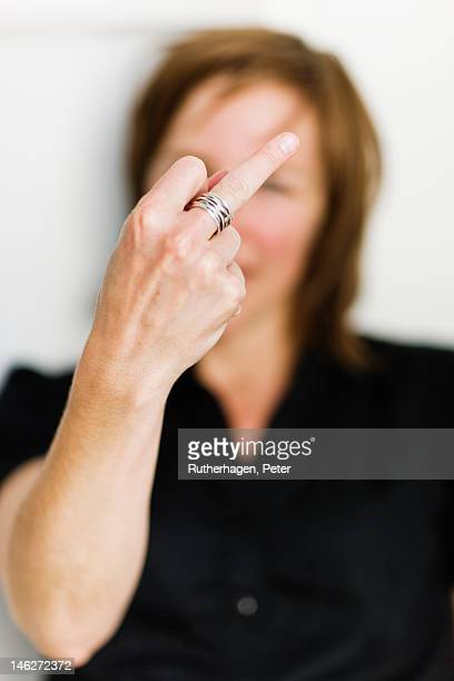 woman gesturing - middle finger funny stock photos and pictures