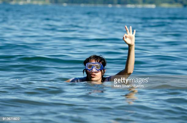 Woman Gesturing While Swimming In River