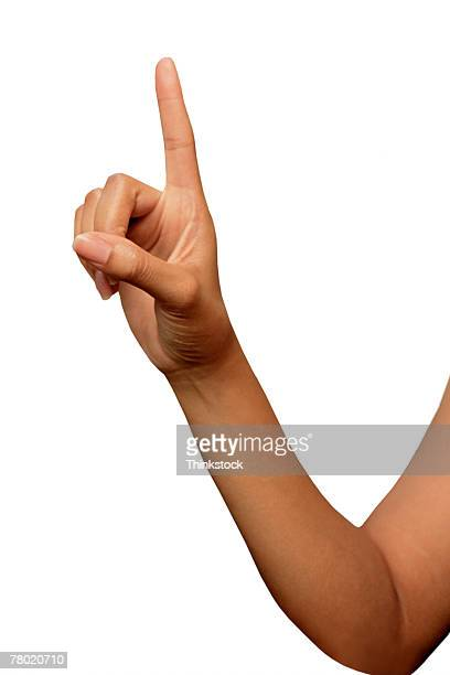 Woman gesturing with index finger
