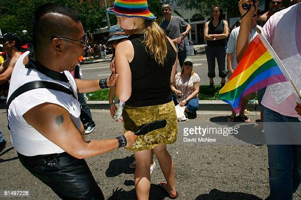 A woman gets a consensual goodnatured spanking from a marcher in the 38th annual LA Pride Parade June 8 2008 in West Hollywood California California...