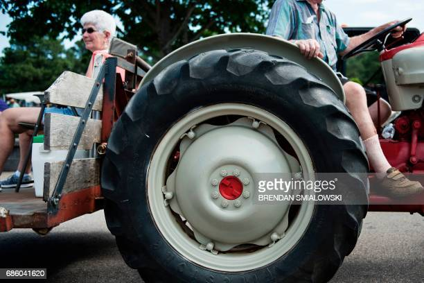 A woman gets a ride on a tractor during the Got to Be NC Festival on the North Carolina State Fairgrounds on May 20 2017 in Raleigh North Carolina /...