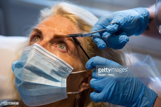 Woman gets an eyebrow wax and tint by Adelle Thomson of Gingers Hair and Beauty on July 22, 2020 in Chapelhall, Scotland. Beauty Salons reopened...