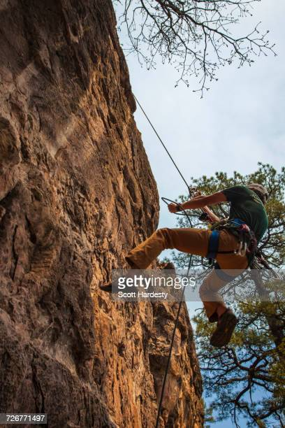 Woman gets chalk while climbing near Flagstaff, Arizona.