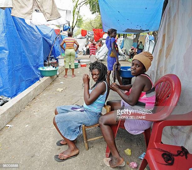 A woman gets her hair braided on April 01 2010 in a tent city of PetionVille a neighborhood of PortauPrince The global community has pledged nearly...