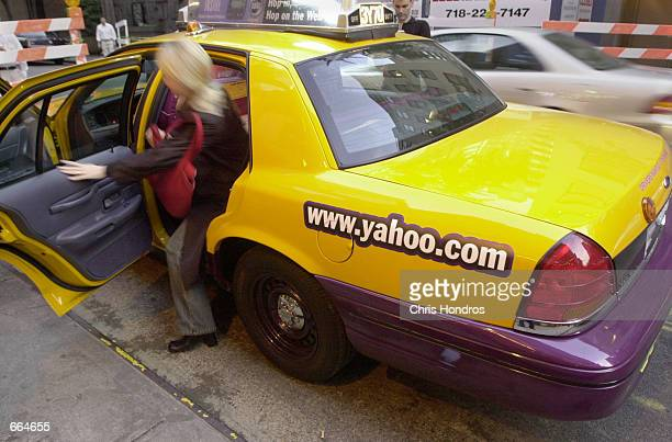 A woman gets out of an Internetenabled taxi October 2 2000 in New York City Yahoo and Medallion Financial a New York finance company have teamed up...