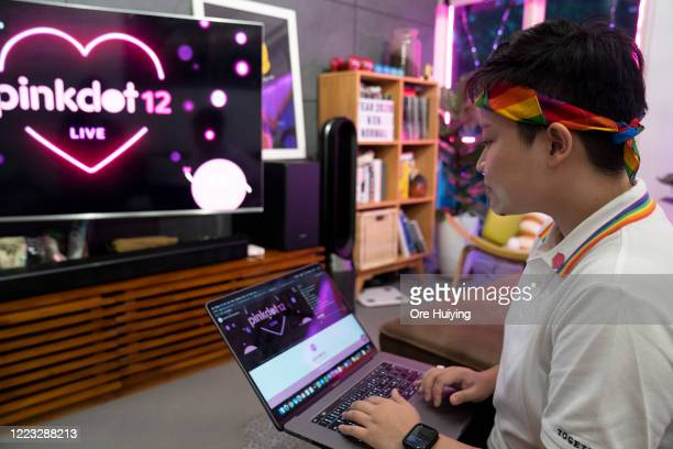 A woman gets ready to start the Pink Dot SG rally livestream in her house on June 27 2020 in Singapore Due to the ongoing coronavirus pandemic this...