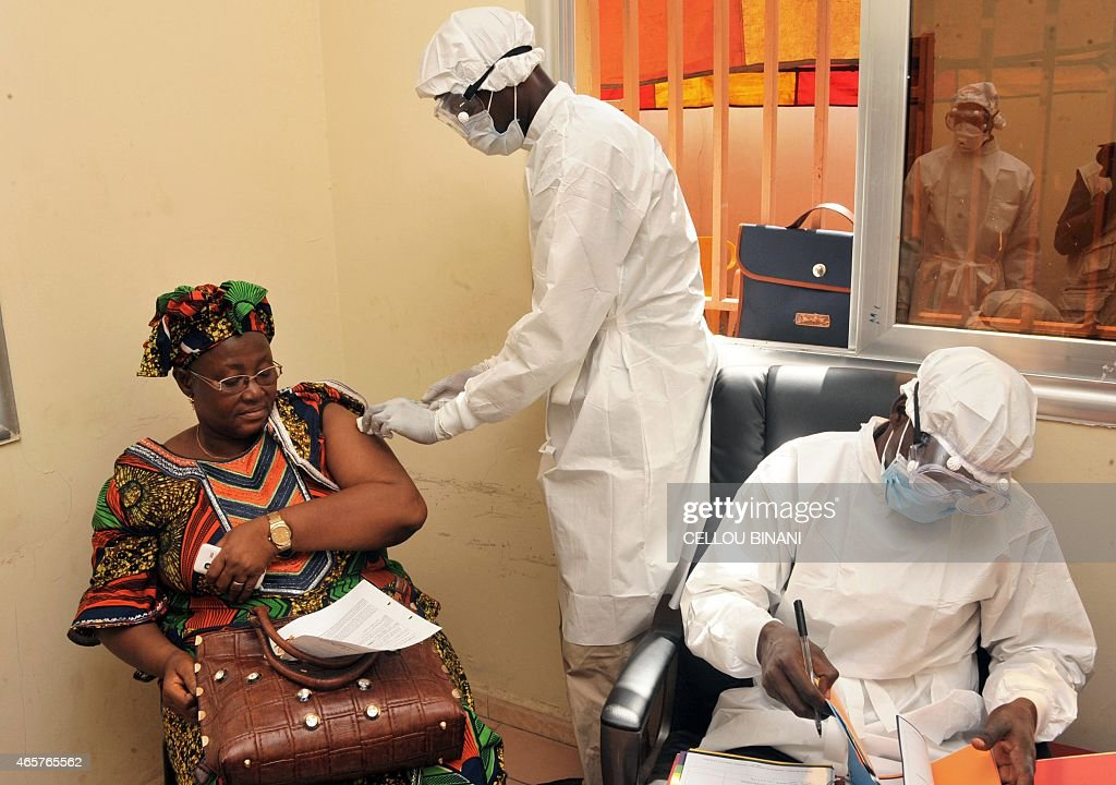 A woman gets vaccinated on March 10, 2015 at a health center in Conakry during the first clinical trials of the VSV-EBOV vaccine against the Ebola virus. The World Health Organization (WHO) said on March 5 that clinical trials launched on March 7 in Guinea marked the last step before the vaccine is available on the market.