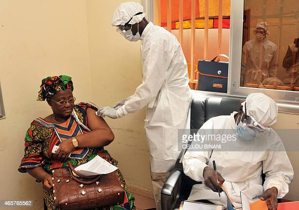 A woman gets vaccinated on March 10 2015 at a health center in Conakry during the first clinical trials of the VSVEBOV vaccine against the Ebola...