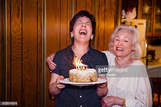 woman getting a birthday cake - happy birthday vintage stockfoto's en -beelden